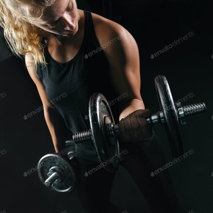 Strong Blonde Woman Lifting Weight