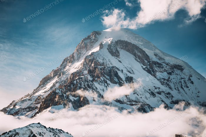Georgia. Peak Of Mount Kazbek Covered With Snow. Kazbek Is A Str