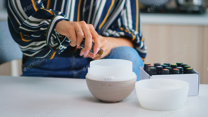 Adding essential oils into diffuser