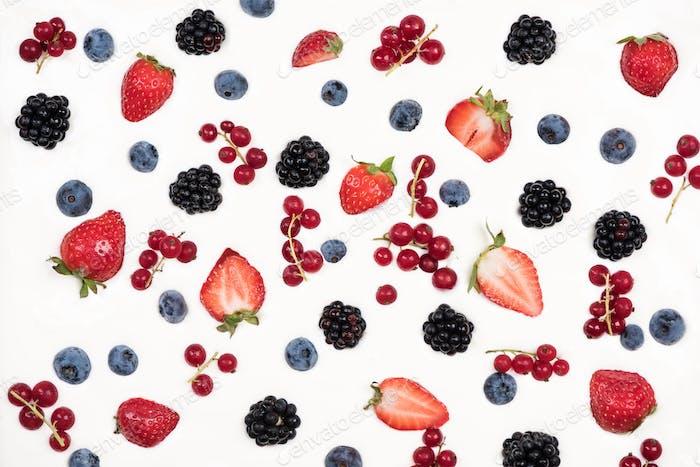 Fresh ripe fruits on youghurt