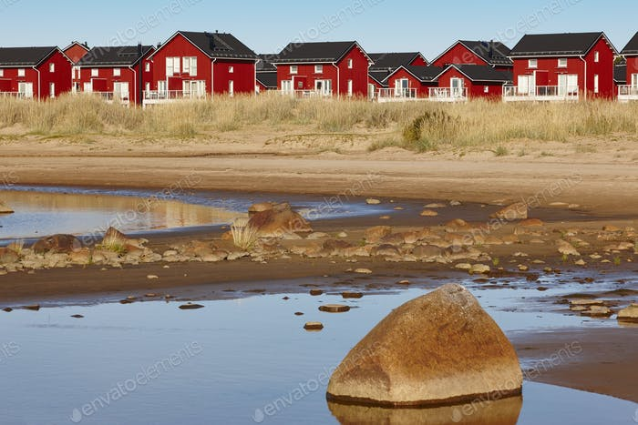 Red wooden houses near Marjaniemi beach, Hailuoto island. Finland. Travel