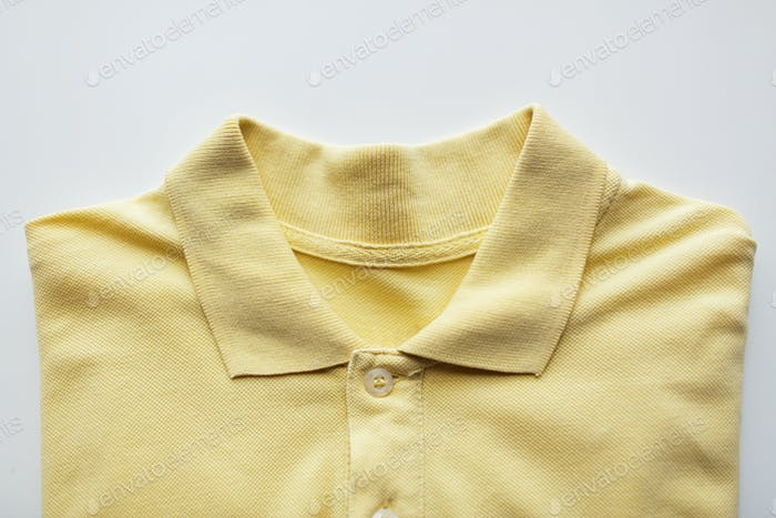 close up of polo t-shirt on white background