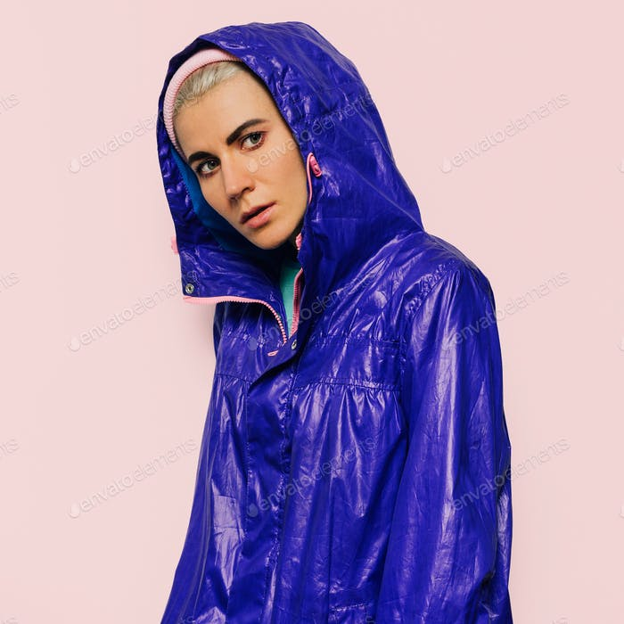Hipster model in bright jacket hood sport style urban Outfit