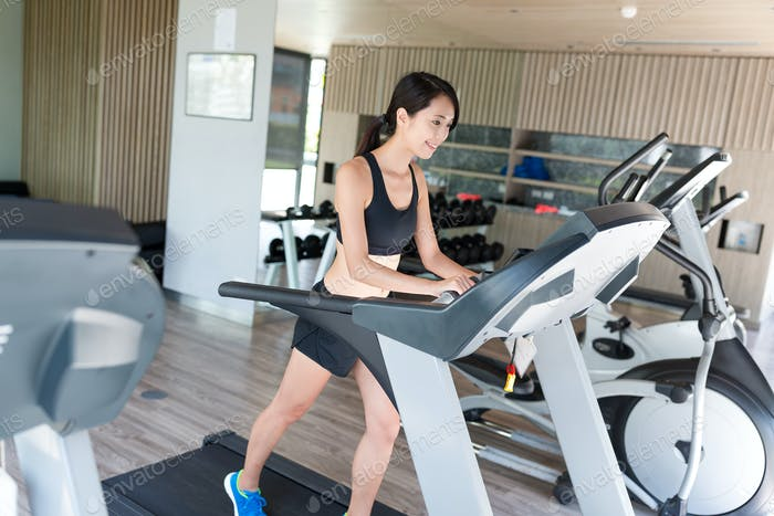 Woman practice on treadmill in gym