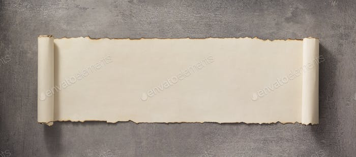 parchment scroll at concrete surface
