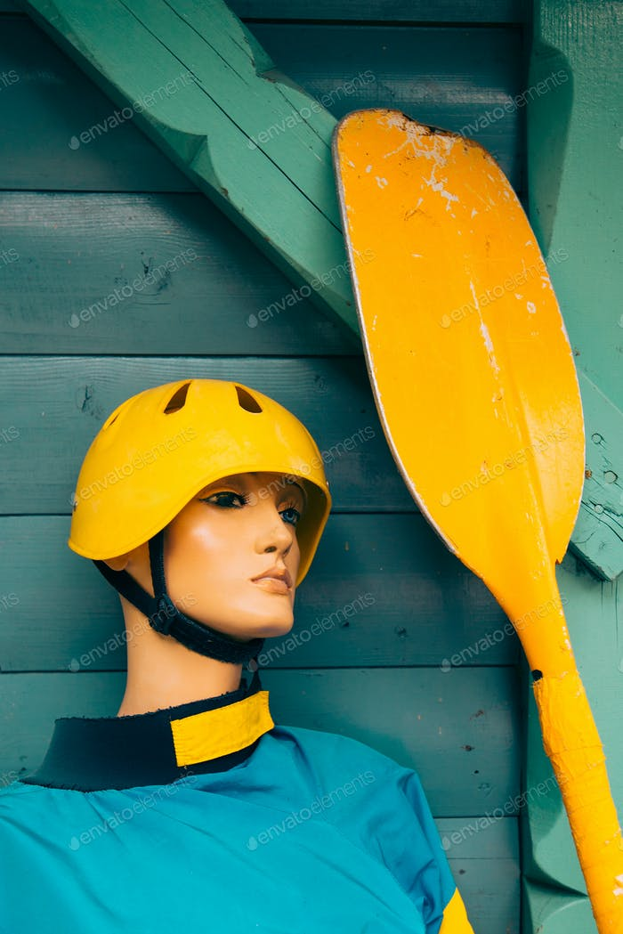 Mannequin with kayaking equipment