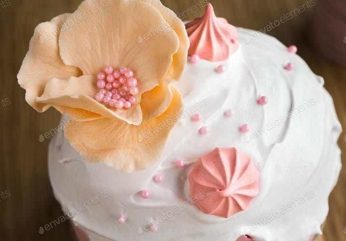 Traditional Easter sweet cake decorated with pink meringue