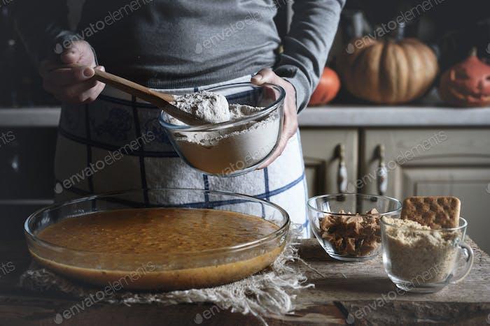 Adding flour in the dough for dump cake