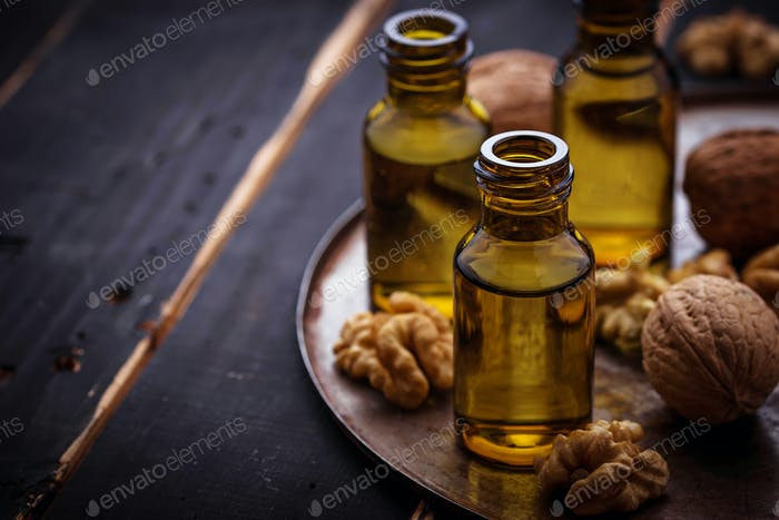 Walnuts oil in small bottles