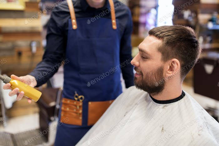 barber showing hair styling spray to male customer