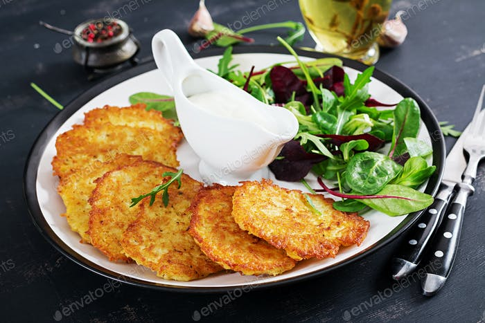 Potato fritters/draniki/pancakes served with sour cream. European cuisine.