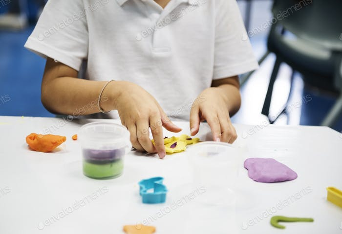 Kindergarten students learning shape with colorful clay