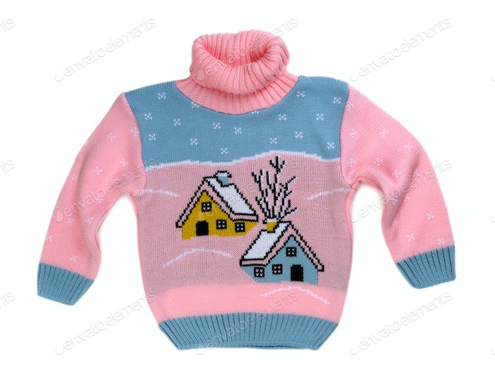 Pink sweater with a pattern of the house.