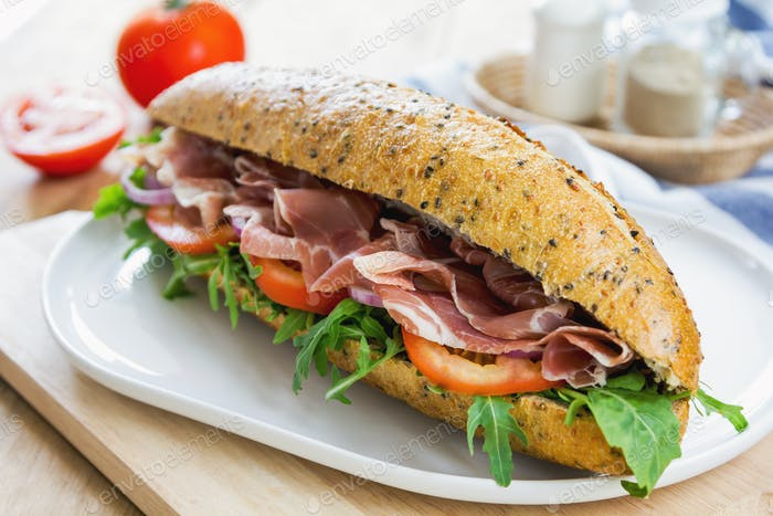 Prosciutto with rocket on sesame baguette