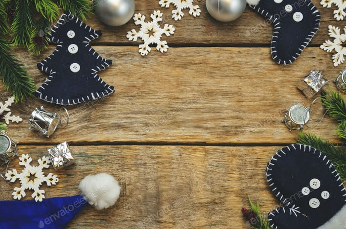 wood background with Christmas tree, snowflakes, Christmas balls