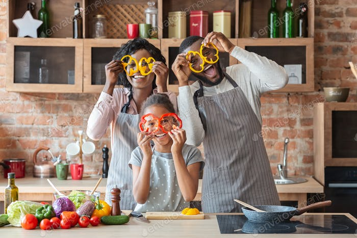 Sweet afro family having fun at kitchen