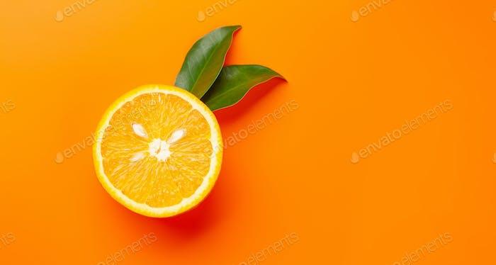 Fresh ripe orange fruit on orange background