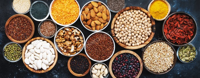 Superfoods, legumes, nuts, seeds and cereals selection in bowls