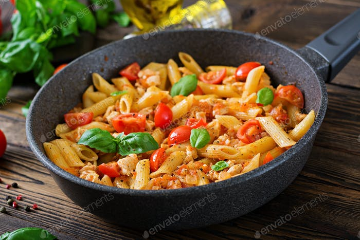 Penne pasta in tomato sauce with chicken