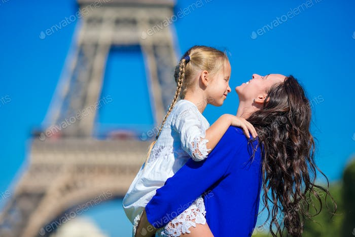 Happy family having fun in Paris background Eiffel Tower