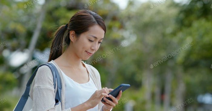 Woman use of mobile phone in city of Hong Kong
