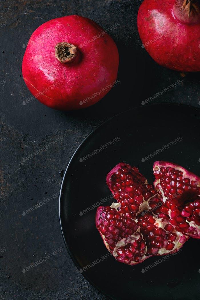 Slice and whole pomegranates