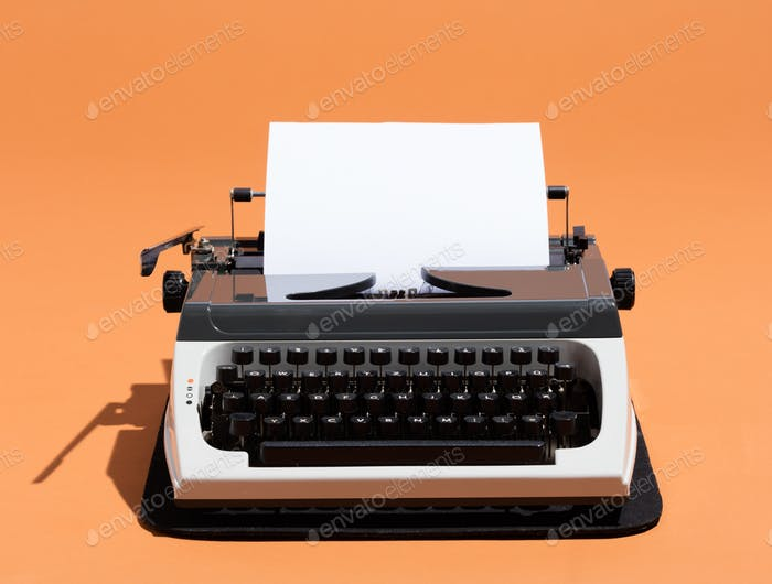 Oldschool typewriter with a blank page