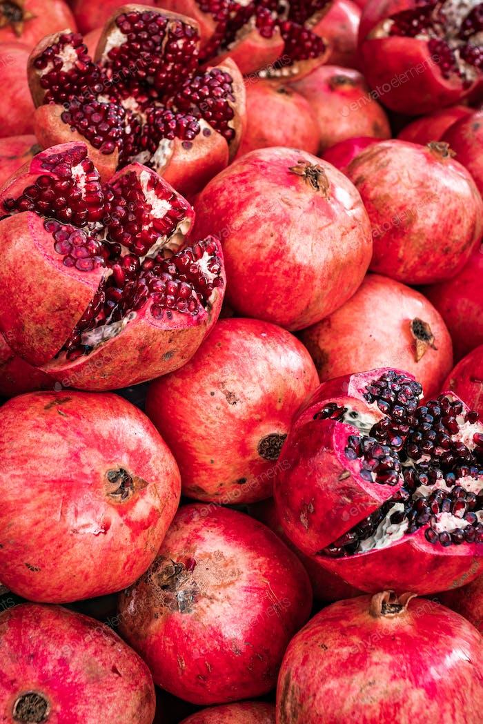 Red pomegranate fruit at street market. Group of pomegranates