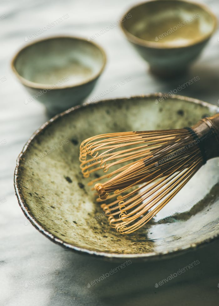 Japanese tools and bowls for brewing matcha tea, selective focus