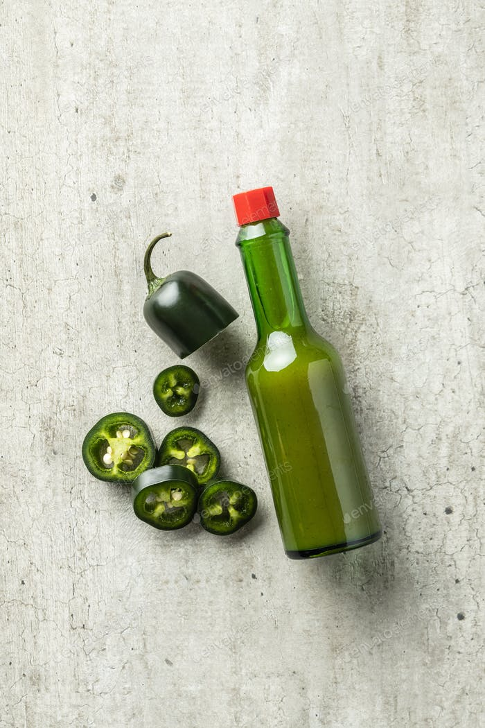 Green jalapeno pepper and tabasco sauce.
