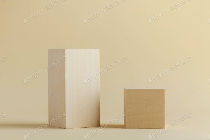 Wooden rectangular shapes on a beige background. Abstract geometric shapes.