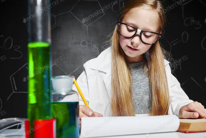 Cute girl at chemistry lesson