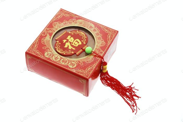 Chinesisches Neujahrskuchen und Schmuckstück