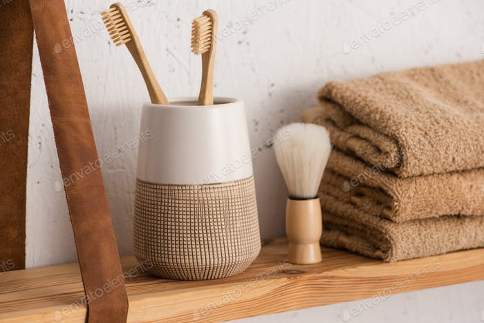 Shelf With Toothbrush Holder With Toothbrushes, Towels And Shaving Brush in Bathroom, Zero Waste