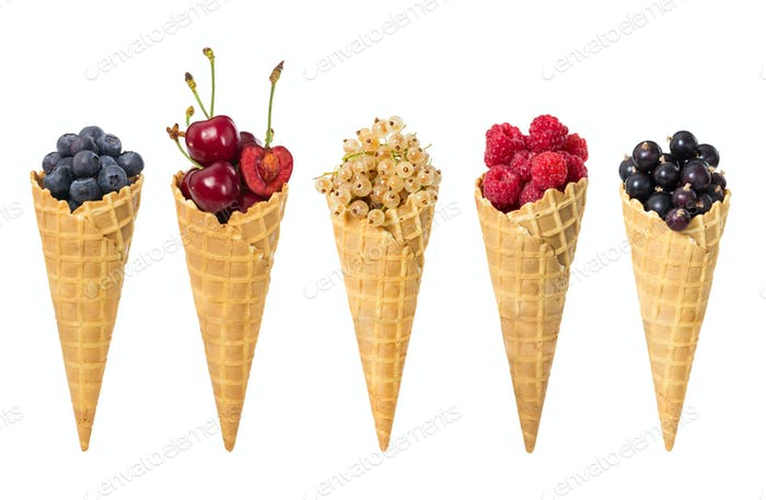 Set of assorted berries fruit in waffle ice cream cone isolated