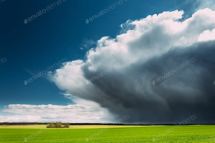 Storm And Rain Above Countryside Rural Field Or Meadow Landscape