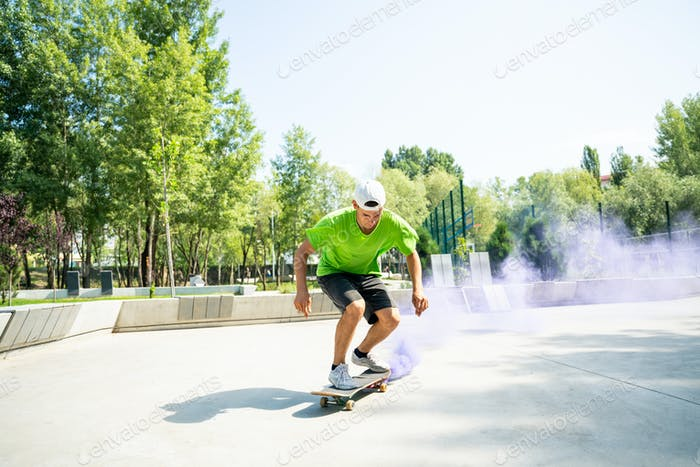 skaters with colored smoke bombs