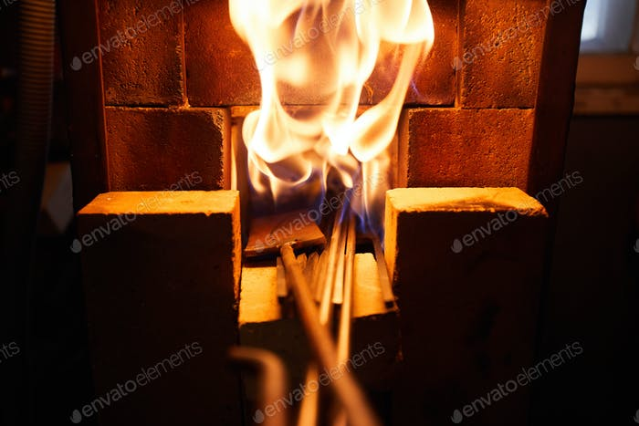 Metal bars in firing furnace