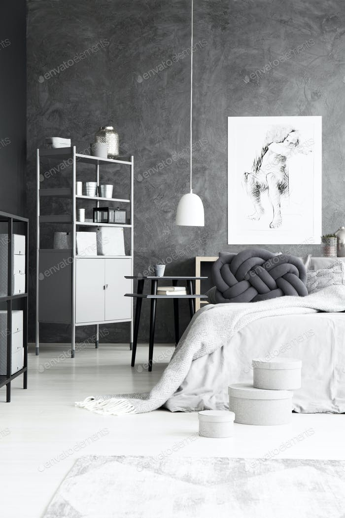 Monochromatic bedroom interior with cabinet