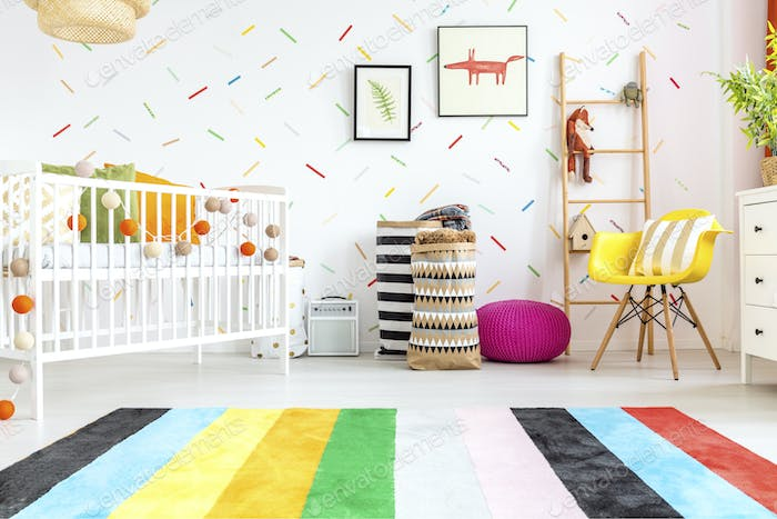 Newborn bedroom with yellow chair