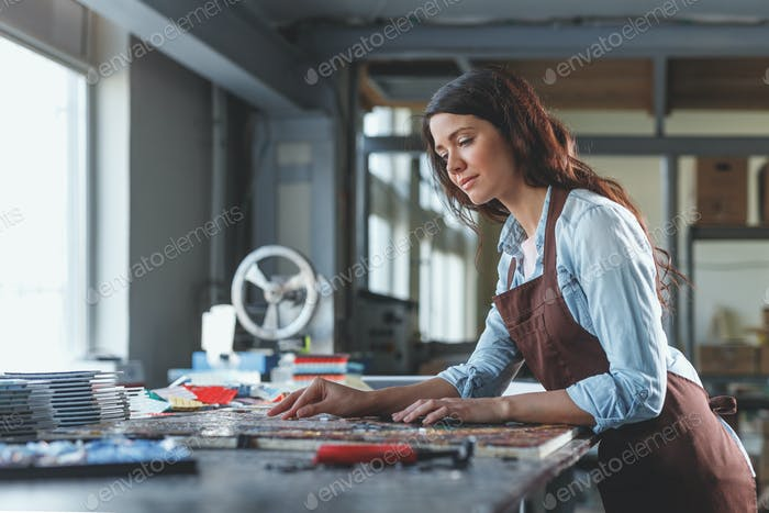 Young woman in workshop