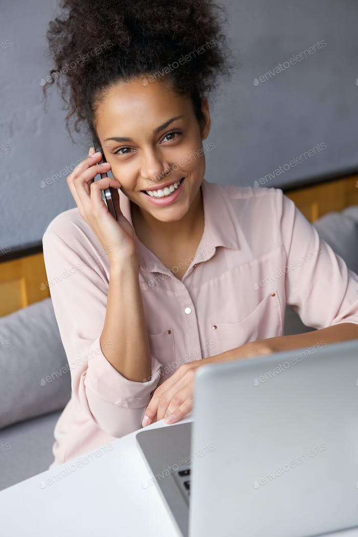 Friendly young woman calling by mobile phone
