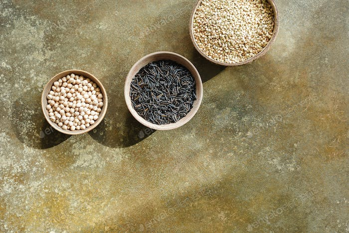 Different types of grains in bowls,wild rice, black bean and green buckwheat