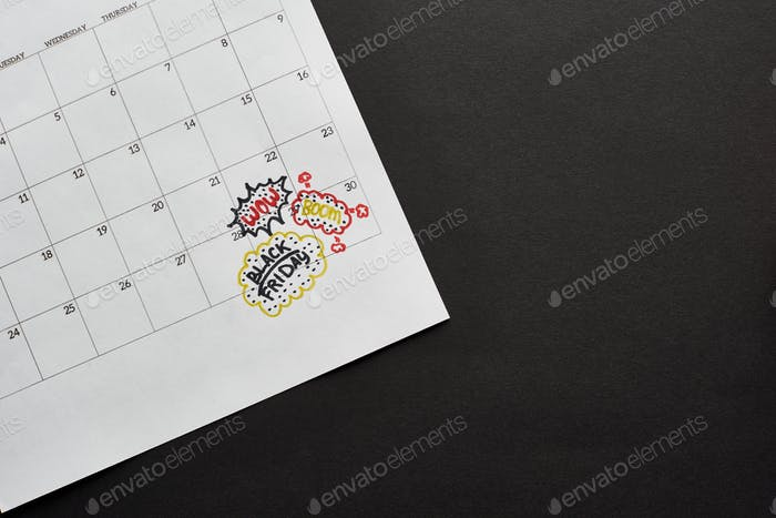 Top View of Calendar With Black Friday Marked Date on Black Background