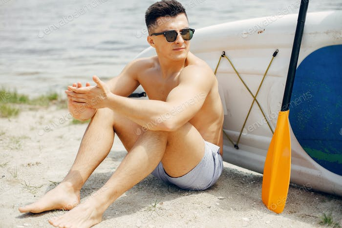 Sup surfer on a summer beach
