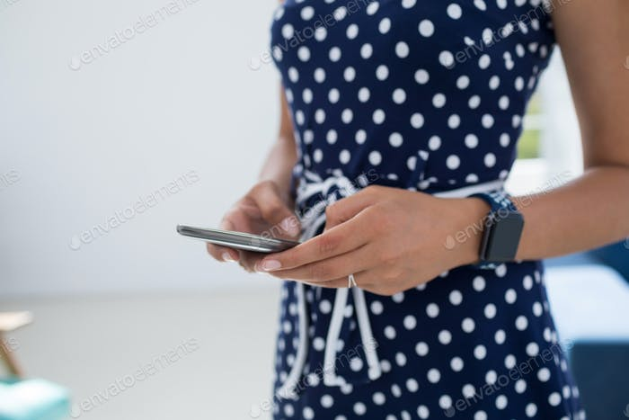 Female executive using mobile phone in the office