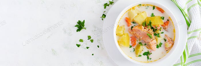 Creamy soup with salmon, potatoes, onions and carrots and  in a bowl. Finnish/ karelian cuisine.