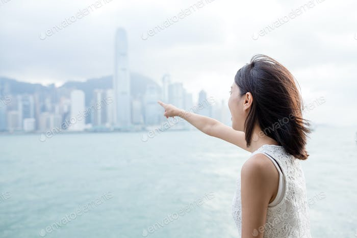 Woman finger pointing to the landmark