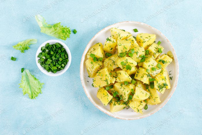Boiled new potato with butter, dill and green onion