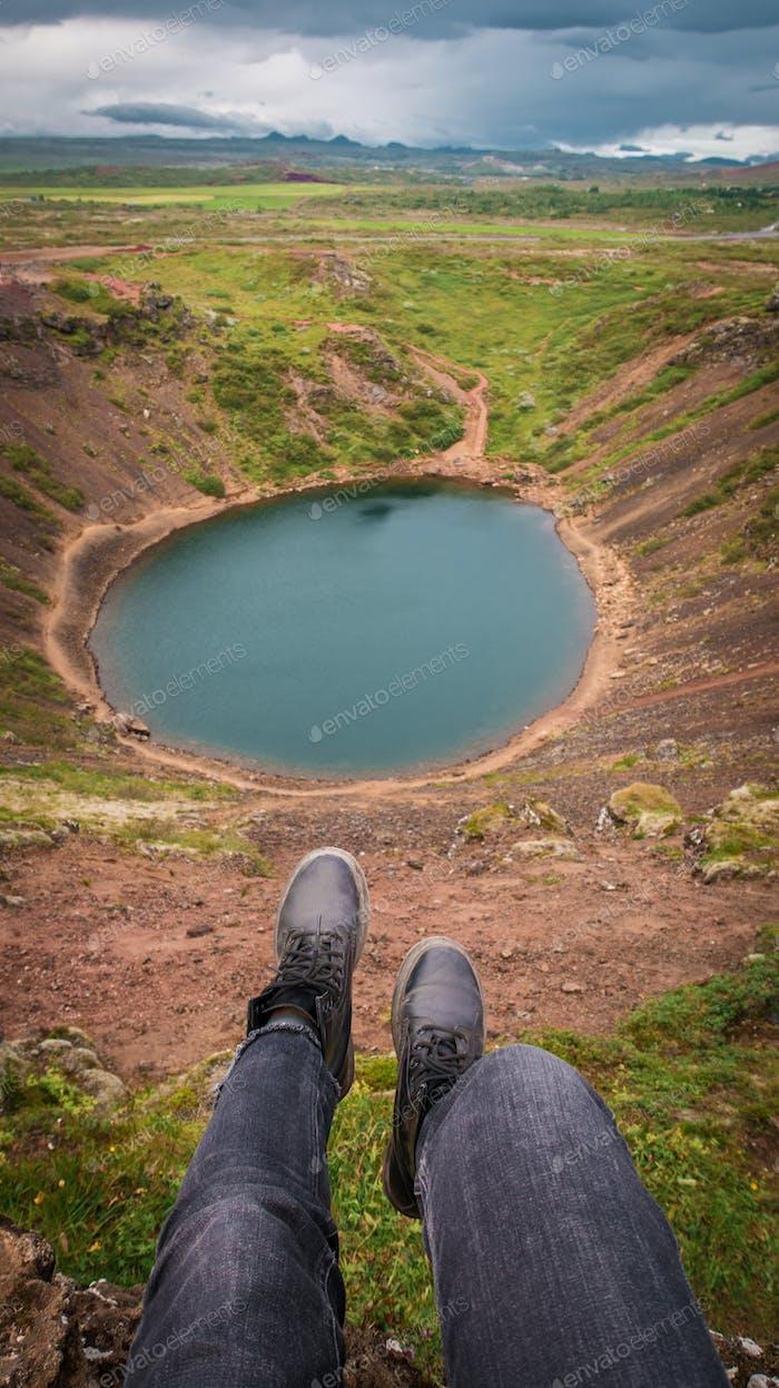 Woman show the blue lake near mountains. Icland